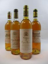 12 bouteilles 3 bts : CHÂTEAU RAYNE VIGNEAU 1975 1er cru Sauternes (2 légèrement bas, 1 haute épaule, étiquettes et capsules abimées)