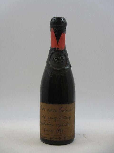 1 demi bouteille CALVADOS DU PAYS D'AUGE 1893 Legoux entrepot Luc sur Mer