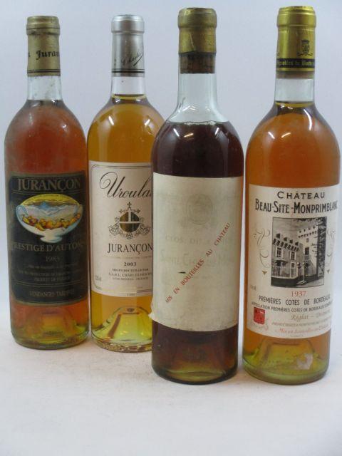 4 bouteilles 1 bt : SAINTE CROIX DU MONT 1949 Clos du Camus (mi épaule étiquette très abimée millésime sur le bouchon) 1 bt : JU...