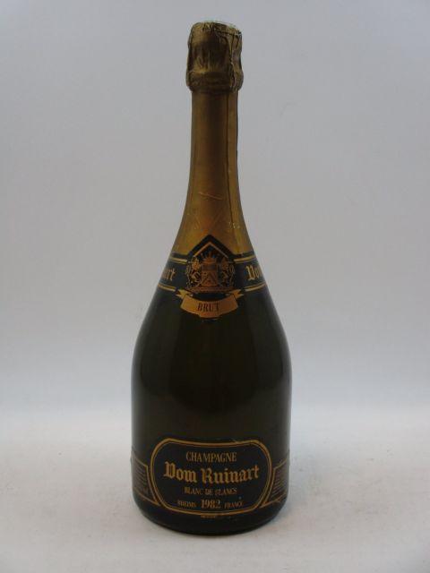 1 bouteille  CHAMPAGNE DOM RUINART 1982 Blanc de blancs   (étiquette lagèrement déchirée) (cave 12)
