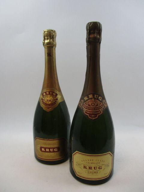 2 bouteilles  CHAMPAGNE KRUG  Grande Cuvée  (2 habillages différents) (cave 12)