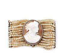 BRACELET En argent et or rose 18k (750), formé de douze rangs de perles fines, coupés de deux barrettes ajourées de feuillages ser...