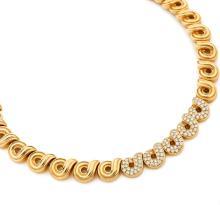 BOUCHERON COLLIER En or jaune 18k (750), articulé d'anneaux flammés et filetés, au centre, cinq d'entre eux sertis de diamants t...