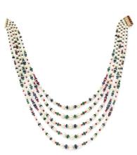 BULGARI COLLIER Formé de cinq chutes de perles de culture, alternées de billettes de rubis, de saphirs et d'émeraudes encadrés o...