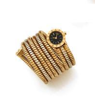 BULGARI SNAKE TUBOGAZ n° 93192 Montre de dame tour de bras en deux ors, rare bracelets tubogaz, lunette or gravée Bulgari, cadra...