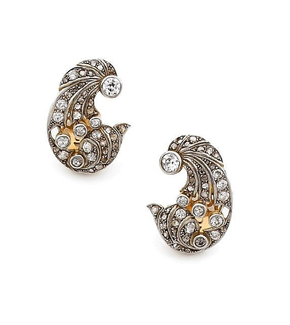A PAIR OF PLATINUM AND YELLOW GOLD EAR CLIPS.