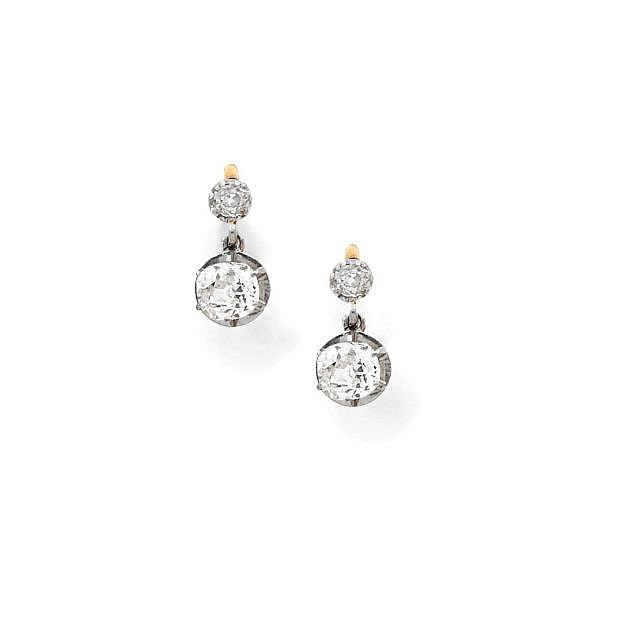 A PAIR OF DIAMOND, PLATINUM AND YELLOW GOLD EARRINGS