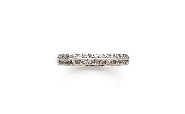 A DIAMOND AND PLATINUM ETERNITY RING