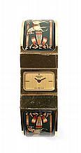 HERMES CLIC-CLAC vers 1990 Belle montre tour de bras en en métal plaqué or. Boîtier rectangle. Cadran or guilloché avec aiguille...