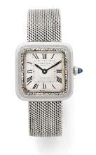 CARTIER Vers 1910 Rare et superbe montre bracelet de dame en platine (950). Boîtier carré. Lunette entièrement sertie de diamant...