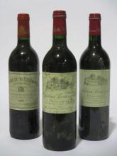 12 bouteilles 2 bts : CHÂTEAU BEAUREGARD 1993 Pomerol (étiquettes fanées et tachées)