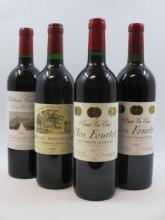 4 bouteilles  1 bt : CHÂTEAU CANON 2003 1er GCC (B) Saint Emilion 1 bt : CHÂTEAU MAGDELAINE 1995 1er GCC (B) Saint Emilion 1 bt...