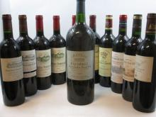 11 bouteilles  1 mag : CHÂTEAU FAUGERES 1999 GCC Saint Emilion 1 bt : CHÂTEAU FOMBRAUGE 1998 GCC Saint Emilion 1 bt : CHÂTEAU FO...