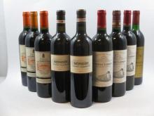 9 bouteilles  1 bt : CHÂTEAU LAROQUE 2011 GC Saint Emilion 1 bt : CHÂTEAU LAROQUE 2004 GC Saint Emilion 1 bt : CHÂTEAU LAROQUE 2...