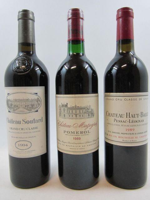 8 bouteilles 2 bts : CHATEAU HAUT BAILLY 1989 CC Pessac Léognan (étiquettes fanées, traces de coulure)