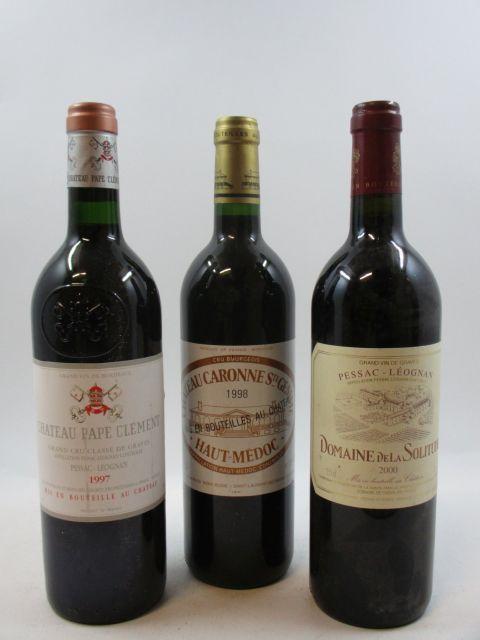 12 bouteilles 5 bts : CHÂTEAU PAPE CLEMENT 1997 CC Pessac Léognan (étiquettes tachées)