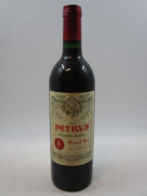 1 bouteille PETRUS 1986 Pomerol (étiquette léger tachée) (cave 7)