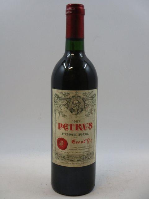 1 bouteille  PETRUS 1987 Pomerol (étiquette tachée, capsule légèrement abimée sur le dessus)  (cave 7)