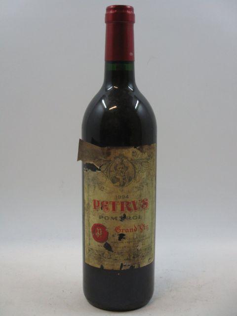 1 bouteille PETRUS 1994 Pomerol (étiquette très abimée et déchirée) (cave 7)