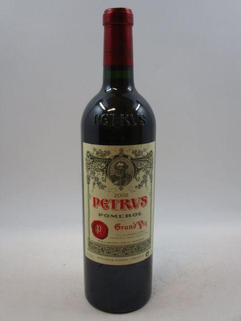 1 bouteille PETRUS 2002 Pomerol (étiquette fanée) (cave 7)