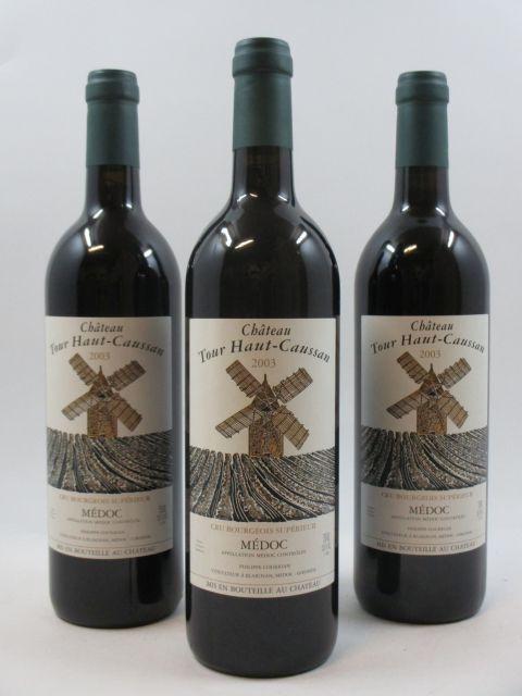 12 bouteilles CHÂTEAU TOUR HAUT CAUSSAN 2003 CB Médoc  (cave 1)