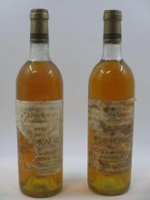 2 bouteilles CHÂTEAU RAYNE VIGNEAU 1976 1er cru Sauternes (niveaux légèrement bas, capsules abimées étiquettes très abimées et déchi...