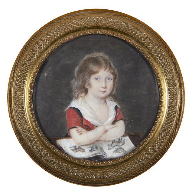 École française vers 1805  Portrait d'Alfred de Vigny enfant avec un livre d'images Miniature de forme ronde