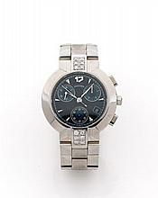 CONCORD Vers 2000  Chronographe bracelet en acier. Boîtier rond., anses serties diamants. Cadran noir avec 3 compteurs bleu. Dat...
