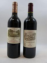 2 bouteilles 1 bt :  CARRUADES DE LAFITE 2004 Pauillac (étiquette fanée, léger tachée)