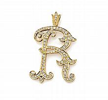 PENDENTIF en or jaune de style XIXème siècle, orné de la lettre