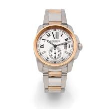 CARTIER CALIBRE, vers 2012 Grande montre bracelet en acier et or rose. Boîtier rond. Fond saphir. Couronne de remontoir sertie d...
