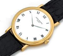PATEK PHILIPPE CALATRAVA, réf. 3992, n° 2891415, vers 1991 Belle montre bracelet en or 18K (750). Boîtier rond. Lunette or guill...