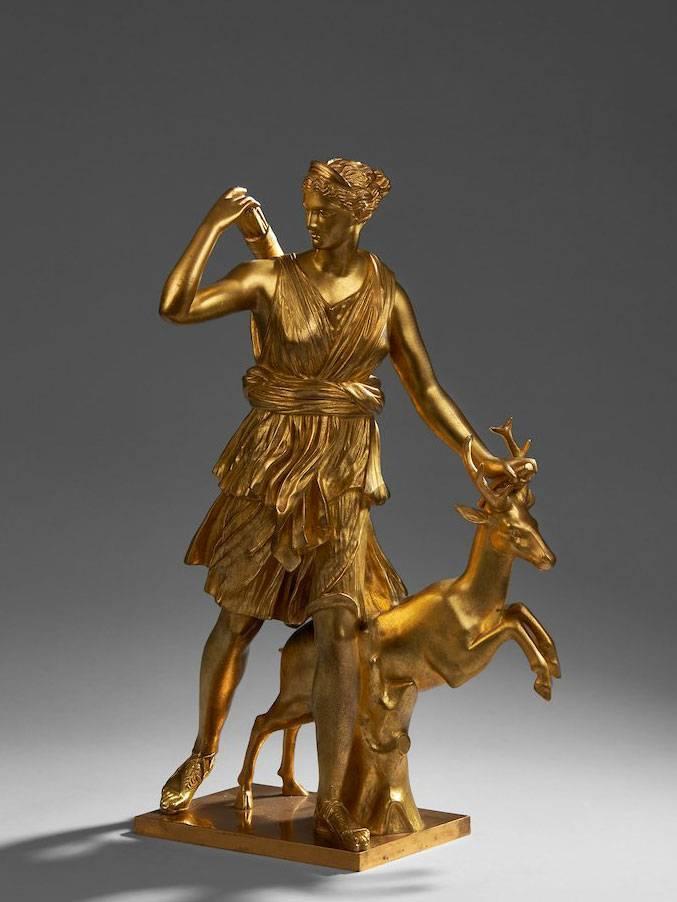 ÉCOLE FRANÇAISE DU XIXe SIÈCLE Artémis à la biche, d'après la Diane de Versailles Groupe en bronze doré