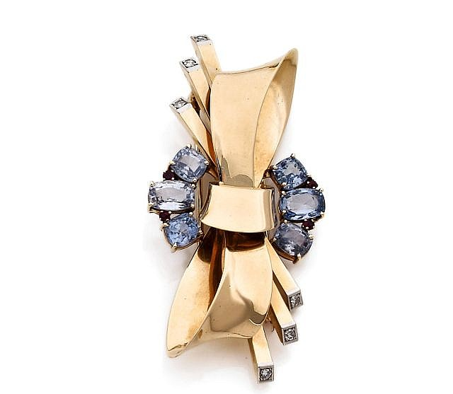 A YELLOW GOLD, SAPPHIRE RUBY AND DIAMOND CLIP BY TRABERT & HOEFFER MAUBOUSSIN.