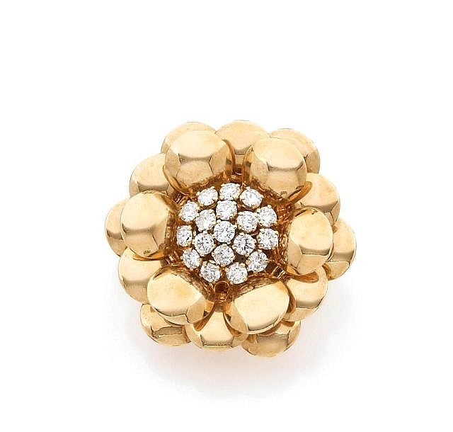 A DIAMOND AND YELLOW GOLD FLOWER CLIP BY VAN CLEEF & ARPELS