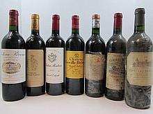 9 bouteilles  1 bt : CHÂTEAU LEOVILLE POYFERRE 2001 2è GC Saint Julien 1 bt : CHÂTEAU PAPE CLEMENT 1989 CC Pessac Léognan (étiquet...
