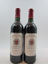 5 bouteilles CLOS BEAUREGARD 2001 Pomerol (la majorité des bouteilles de cette cave ont des étiquettes protégées par un film plastiq...
