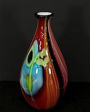 A hand made designer art glass vase sculpture