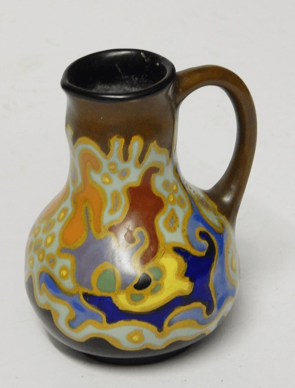 Kleiner Henkelkrug,Keramik,bodenseitig bezeichnet Gouda-Nancy 129, Höhe ca.11,5 cm