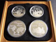 1976 Four-Coin Sterling Silver Canadian Olympic Set.  Includes Wood/Leather Box & COA.