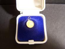 Miniature Gold Saint Gaudens with Gold Bezel.