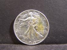 1938 Walking Liberty Half-Dollar.  Bright White Coin with strong details!