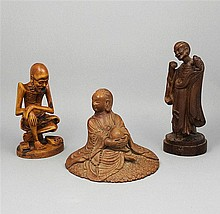 Group of three Asian wooden figures