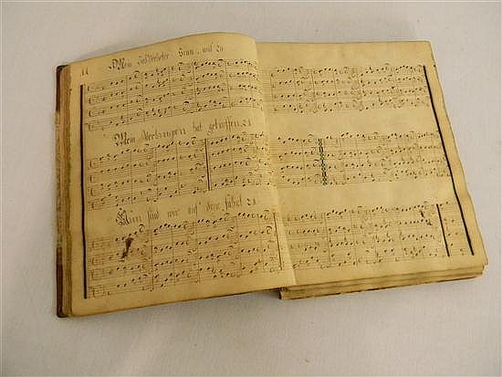 Manuscript: Pennsylvania Dutch manuscript music volume dated Ephrata 1747 with elaborate double page title page in pen and ink, foll...