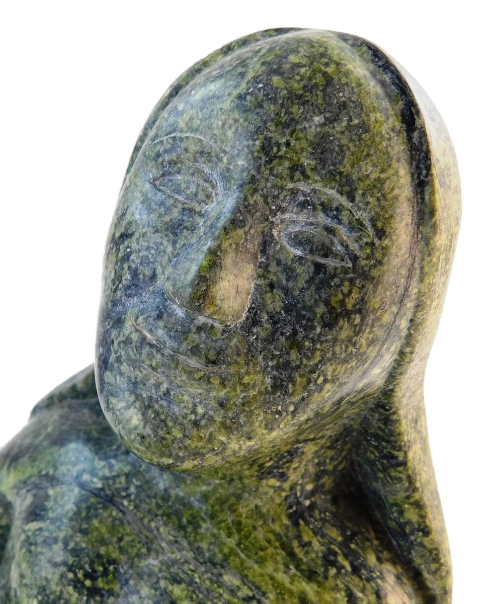 Inuit carved Goddess of the Sea sculpture, late 20th C., carved from single piece of green stone, no signature found, depicts seated...