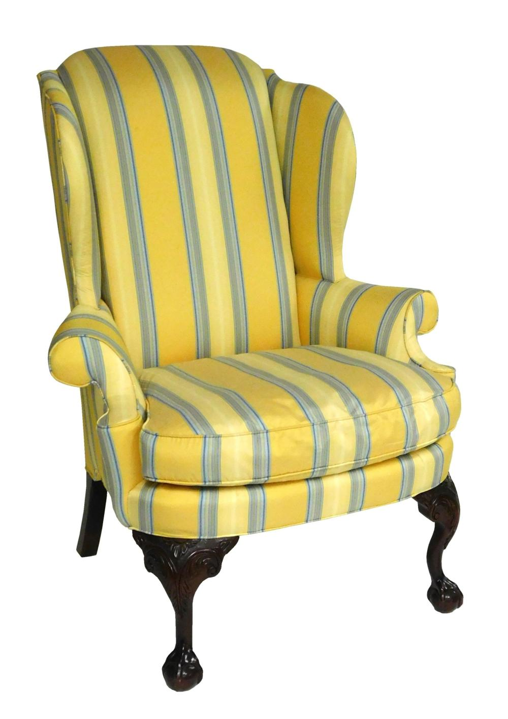Chippendale style wing chair and companion ottoman by Century Furniture, Hickory, N.C., both with yellow and blue silk-type upholste...
