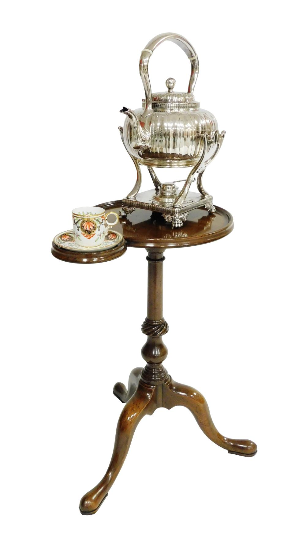 Tiffany & Co silver-plate teapot on Kittinger for Williamsburg Restoration kettle stand, and accompanying porcelain cup and saucer,...