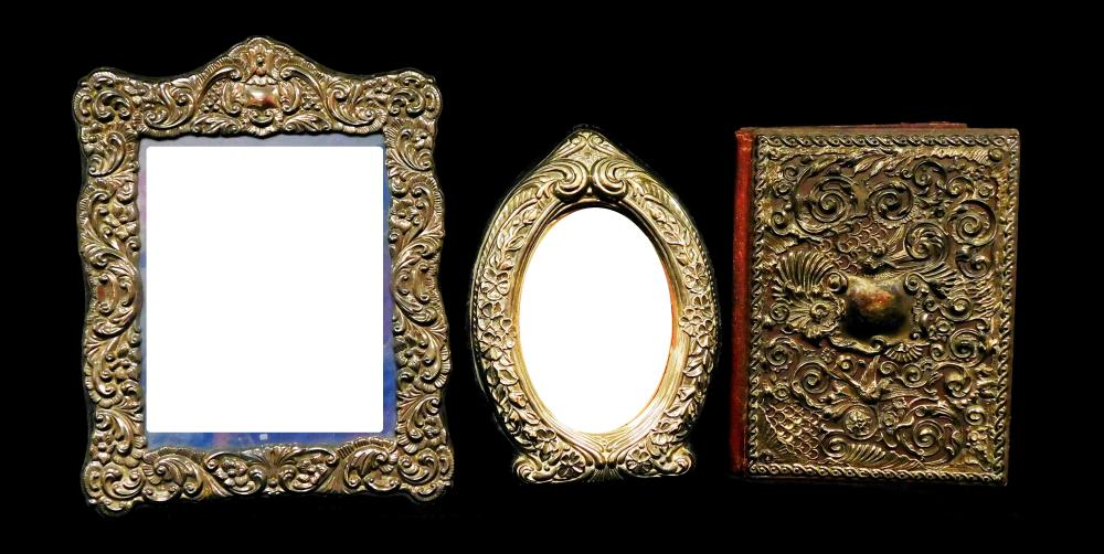 SILVER-PLATE: Three pieces of ornate repousse silver-plate, two frames and one portfolio cover, details include: portfolio cover wit...
