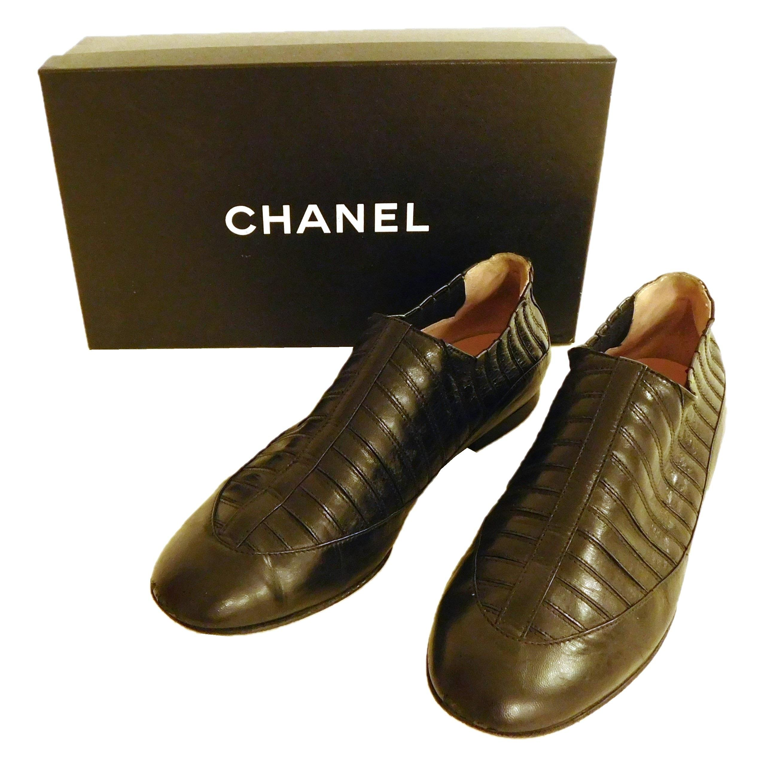VINTAGE CLOTHING: One pair women's Chanel flats, size 38, unusual style of striped black leather, with stretch elastic between panel..