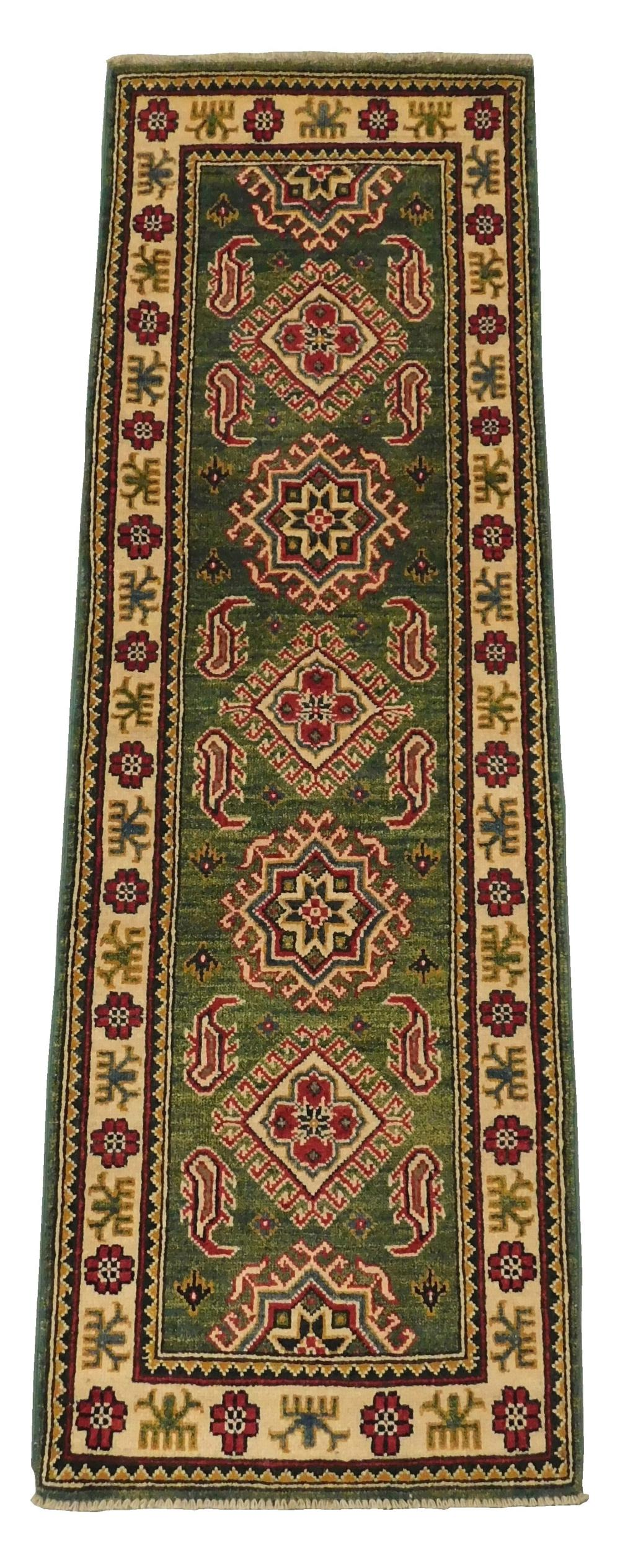 "RUG: Uzbek Kazak, 2' x 6'2"", hand-knotted, 100% wool on cotton, green ground with red, white and blue geometric border, light wear c."